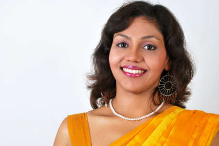 Young beautiful smiling Indian woman for advertising. Stock Photo