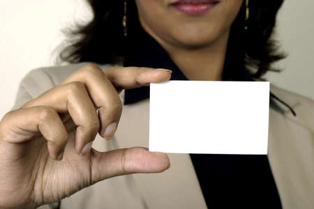 Business card closeup - young businesswoman  holding blank empty business card Stock Photo