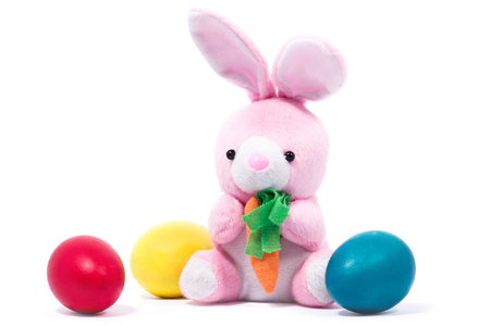 pink plush rabbit with carrot, isolate, festive easter rabbit with easter eggs