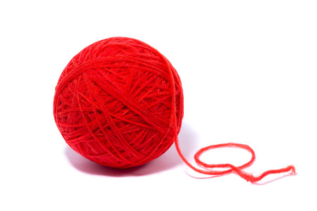 red ball of yarn for knitting, isolate, homemade crafts 写真素材