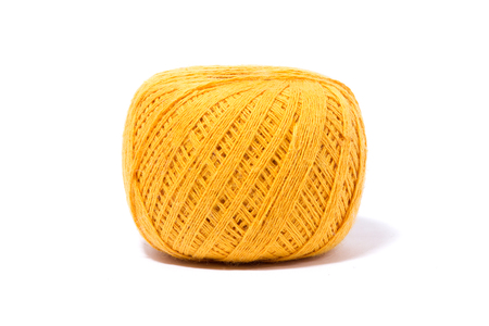 a ball of yellow knitting yarn, isolate, homemade handicrafts, woolen yarn