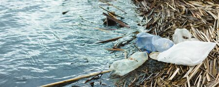 ocean rubbish banner. Polluted coastline, with place for an inscription. Panoramic view of the riverbank polluted with plastic waste