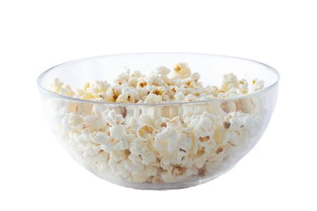 glass cup with salted popcorn, isolate. The concept of vegetarian food to watch movies