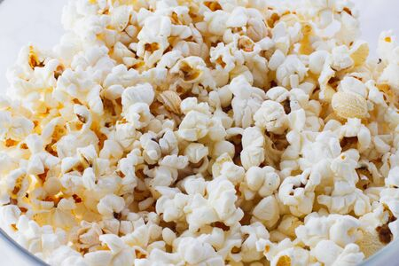 texture of fried popcorn closeup, top view. American dessert to watch movies