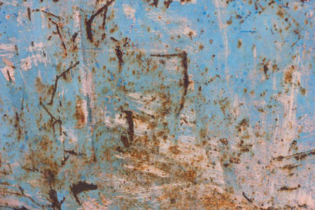 Rusty Colored Metal Texture. The Old Iron Surface Is Worn. Cracked Paint