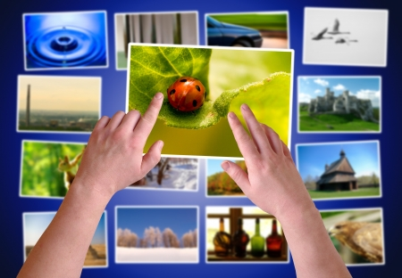 Hands choosing photos on virtual desktop  Stock Photo - 15764152