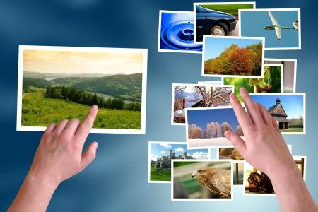 Hands choosing photos on virtual desktop  Stock Photo - 15764167