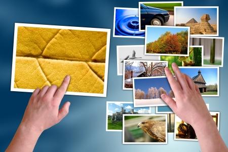 user friendly: Hands choosing photos on virtual desktop