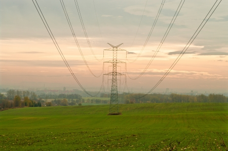 High voltage pylons and power lines to the city Stock Photo - 16797110