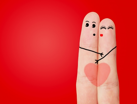 A happy couple in love with painted smiley  Funny fingers Stock Photo - 17207941