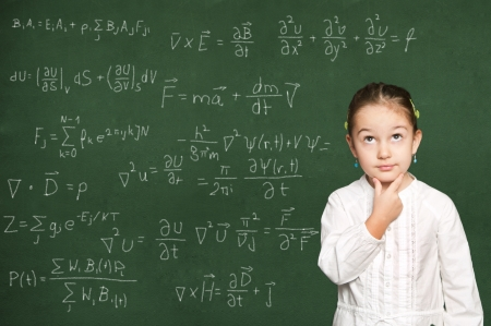 smart girl thinking, green chalkboard background Stock Photo - 18038504