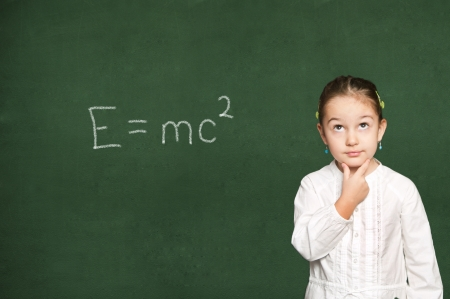 smart girl thinking, green chalkboard background  Stock Photo - 18038478