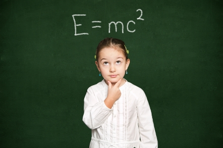 smart girl thinking, green chalkboard background Stock Photo - 18038313