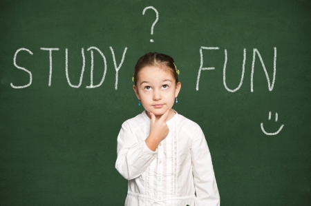 smart girl thinking, green chalkboard background Stock Photo - 18038502