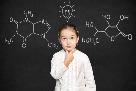 smart girl thinking, black chalkboard background  Stock Photo - 18038472