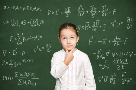 smart girl thinking, green chalkboard background  photo