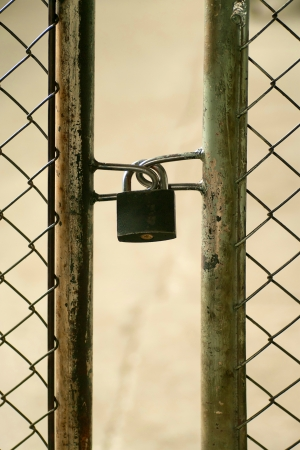 metal doors padlocked, old gate Stock Photo