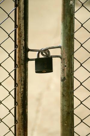 padlocked: metal doors padlocked, old gate Stock Photo