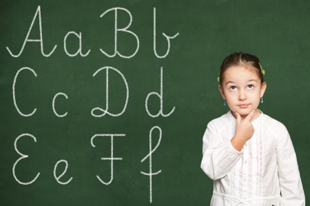 learning to write,  girl thinking Stock Photo - 19569813