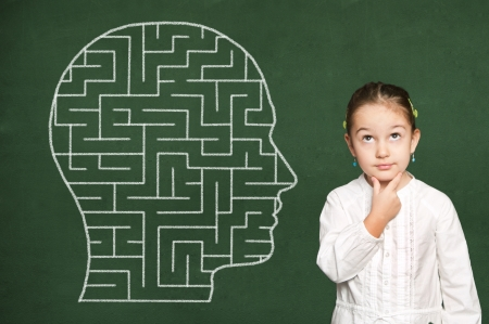 Maze in head on green chalkboard Stock Photo - 19569824
