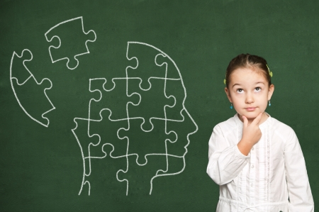 Puzzle in head on green  chalkboard Stock Photo - 19569812