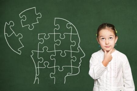 Puzzle in head on green  chalkboard
