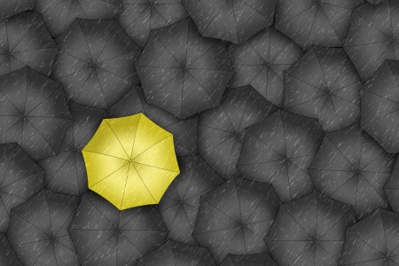 Yellow umbrella  Bright yellow umbrella among set of black umbrellas   photo