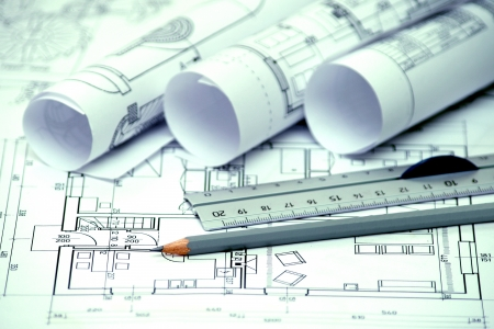 heap of architectural design and project blueprints drawings of house  technical drawings  photo