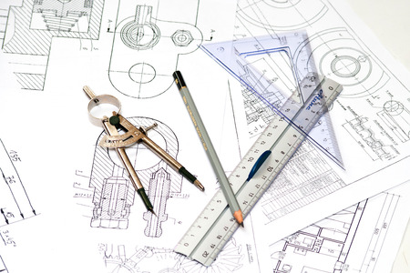 drafting tools: Tools and papers with sketches on the table  technical drawings  Stock Photo