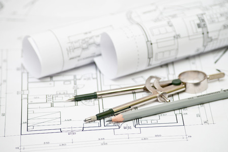 drafting tools: heap of architectural design and project blueprints drawings of house. technical drawings.