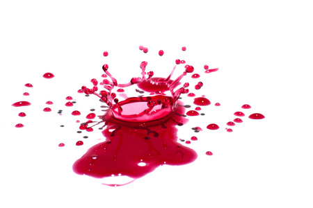 Glossy red liquid droplets (splatters) isolated on white. Standard-Bild