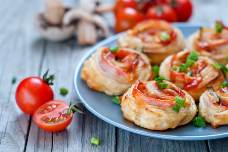 chese: Puff pastry rolls with ham and chese. Baked snacks.