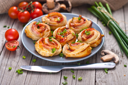 Puff pastry rolls with ham and chese. Baked snacks. photo
