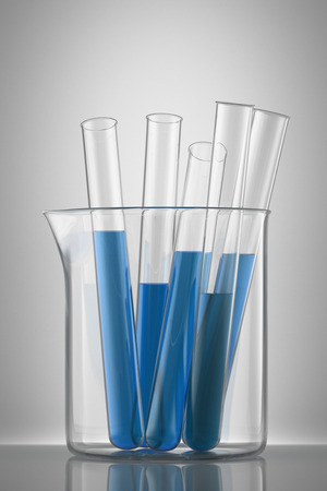 Chemical flask with a blue laboratory test tubes inside, isolated  photo