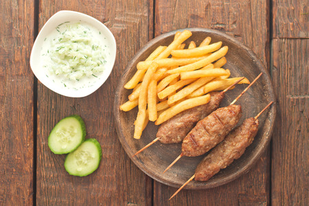 Cevapcici with tzatziki. The traditional Balkan dish. photo