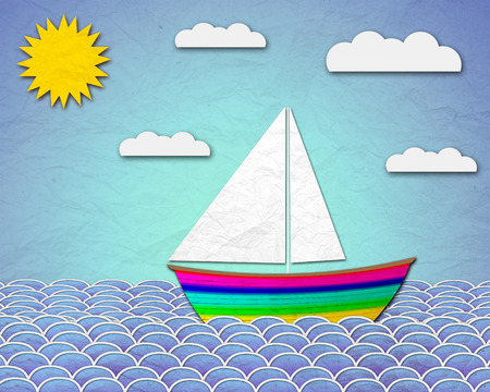 paper boat sailing at sea photo