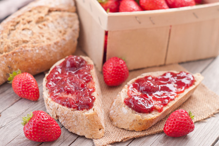 sweet strawberries jam on bread slice photo