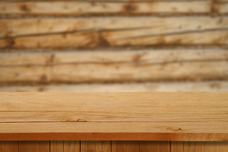 Christmas holiday or party background with empty wooden deck table over festive bokeh. Ready for product montage