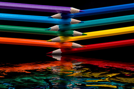 color pencil: colored pencils on black background reflected in water Stock Photo