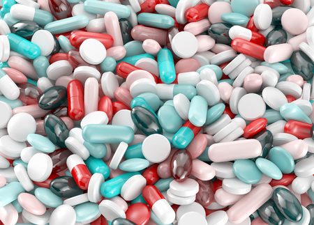 dissolved: Tablets and pills multicolor. Medical background. Stock Photo