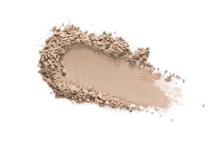 Face makeup powder texture. Beige eye shadow swatch smudge isolated on white. Light brown make up product sample closeup