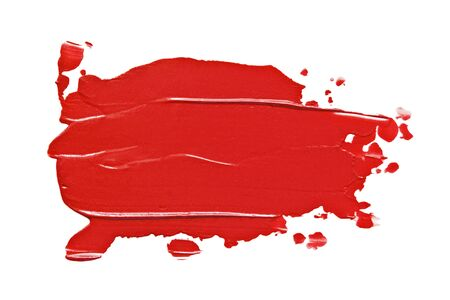 Red color lipstick swatch. Makeup beauty product smear smudge isolated on white background. Creamy matt lipstick texture