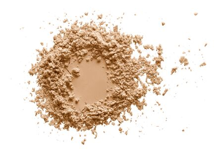 Makeup powder texture. Crushed  beige foundation swatch isolated on white background. Natural color cosmetics sample