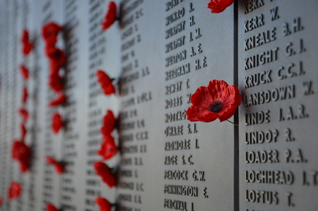 Canberra: CANBERRA, 20022016. Poppies left by visitors to the Australian War Memorial Wall of Remembrance with the splash of red. The Red Poppy has Special Significance for Australians and is worn on Remembrance Day  ANZAC Day each year. Editorial