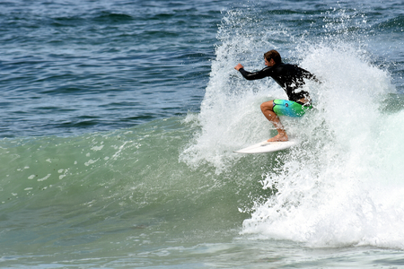amateur: Amateur surfer is surfing on the beach