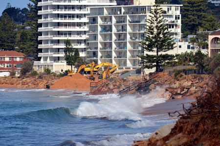 falling tide: Sydney, AUSTRALIA - Jun 26, 2016 Collaroy Beach is still closed and under construction. Intense storm Lashing the coast has Causa Significant erosion on Sydneys northern beaches on June 4th.