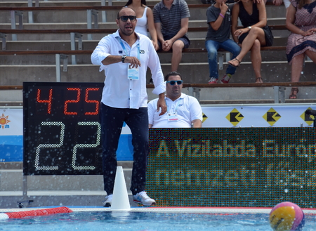 Budapest, Hungary - Jul 14, 2014 Ivica Tucak (head coach) talking to his team. The European Waterpolo Championship was held in Alfred Hajos Swimming Centre in 2014th