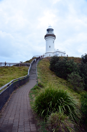 Scenic Hill Approaching White Byron Bay Lighthouse Stock Photo