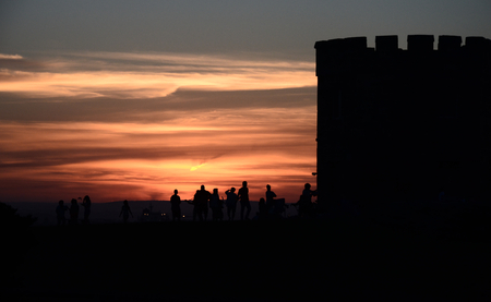 octogonal: Barack tower at La Perouse (Sydney, NSW, Australia). People resting at the tower and watching the sunset.