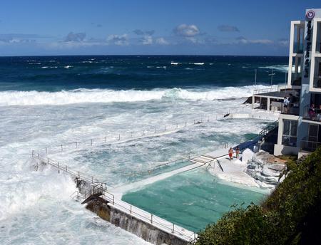 high tide: Sydney, Australia - Oct 23, 2016 Bondi Icebergs swimming pools with ocean view at high tide. Big tide at the beach Bondi Icebergs Club waves fill the pool.